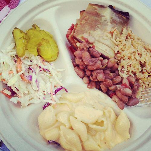 Cole slaw, pickles, mac n' cheese, eggplant, rice n' beans.