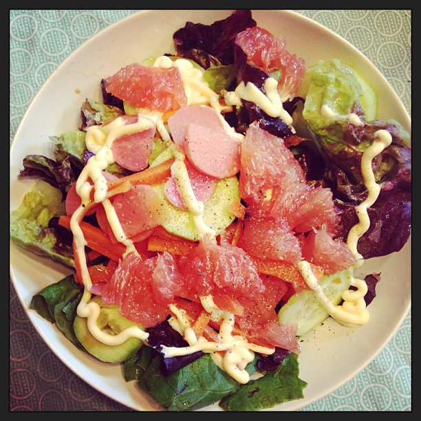 Salad time: greens, grapefruit, pickled radish and onion, dressed in sesame oil, lime, and kewpie.