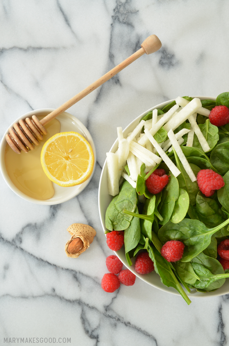 Quick, healthy and delicious. Juicy raspberries, cripsy jicama and tender baby spinach dressed in a sweet dressing made with honey, lemon, and roasted almond oil. Yum!