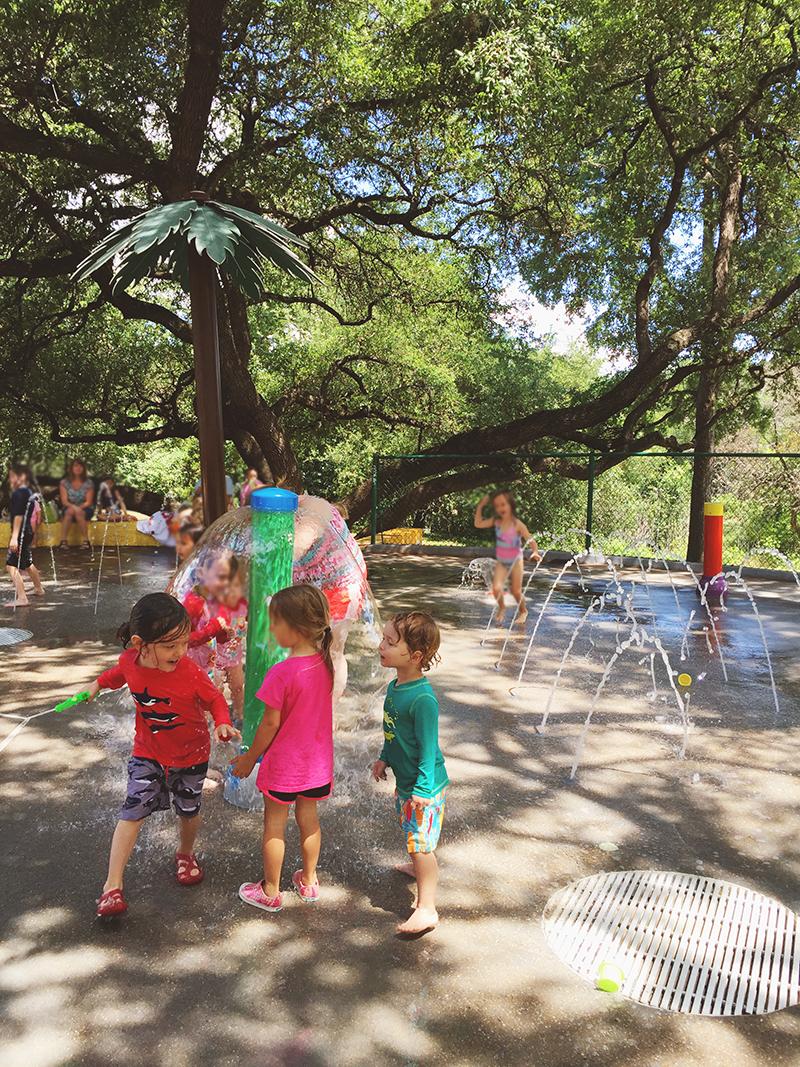 Having fun at the splash pad in Roy Guerrero Park Austin TX